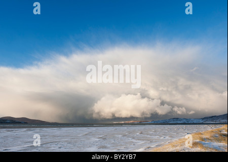 Dramatic clouds of approaching winter snow squall over Luskentyre beach, Isle of Harris, Outer Hebrides, Scotland - Stock Photo