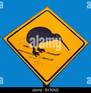 A skiwi,  a road sign for a kiwi altered to show the kiwi ski-ing in new zealand - Stock Photo