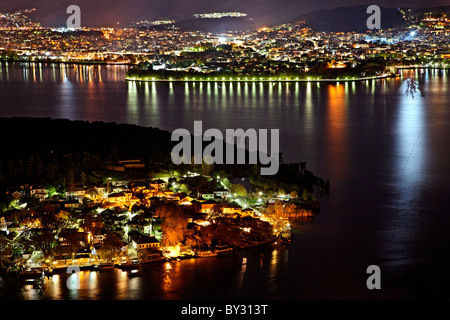 Panoramic night view of Ioannina town, its lake ('Pamvotis' or 'Pamvotida'), the islet of the lake and its village. - Stock Photo