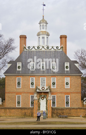 Tourist and Interpreter admiring the Christmas decorations at the Governor's Palace in Historic Colonial Williamsburg, - Stock Photo