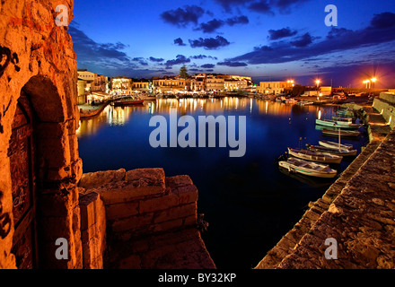 The old Venetian harbor of Rethymno town around the 'blue' hour. Crete island, Greece. - Stock Photo
