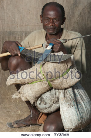 Portrait of old Muslim African Man by explorer Kypros - Mozambique Africa - Prawn fisherman with fishing spear - Stock Photo