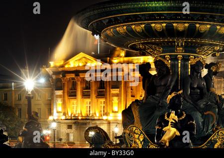 Hotel de Crillon and the fountains in Place de la Concord in Paris - Stock Photo