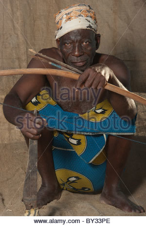 Portrait of old Muslim African Man by explorer Kypros - Mozambique Africa - archer with handmade bow and arrows - Stock Photo