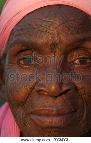 Portrait of old Muslim African woman by explorer Kypros - Mozambique Africa - facial tattoo tattoos tattoo's - Stock Photo