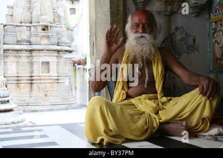 Sadhu sat in the Temple complex, Jagdish Temple, Udaipur, Rajasthan, India - Stock Photo