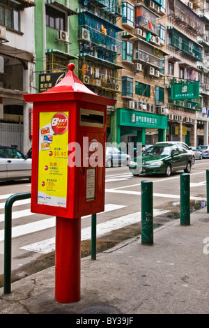 Red pillar or posting box in a street in Macau SAR People's Republic of China. JMH4160 - Stock Photo