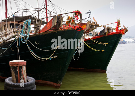 Fishing boats tied up in harbour Macau SAR People's Republic of China. JMH4161 - Stock Photo