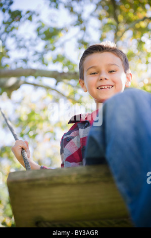 USA, New York, Flanders, Boy (8-9) playing in garden - Stock Photo