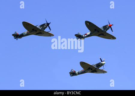 Spitfire LF.XVIe, TR.IXe trainer, and FR.XVIIIe formation flypast at Duxford Flying Legends Airshow - Stock Photo