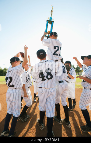 USA, California, Ladera Ranch, Boys (10-11) from Little league celebrating after winning - Stock Photo