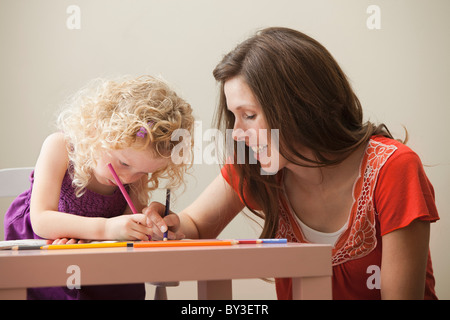 USA, Utah, Lehi, mother and daughter (2-3) drawing together - Stock Photo