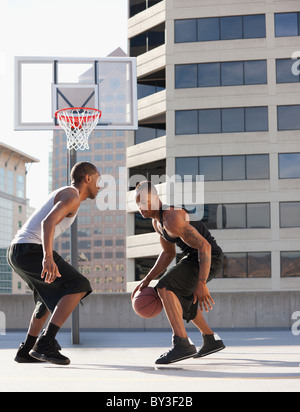 USA, Utah, Salt Lake City, two young men playing basketball - Stock Photo