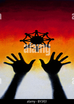 One world unity symbol above black hand prints made with multicoloured sunset style coloured powder. India - Stock Photo