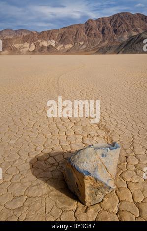 USA, California, Moving rock in desert - Stock Photo
