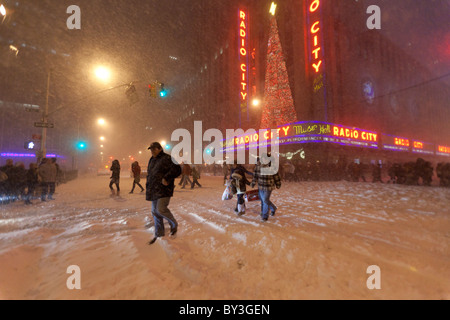 People leaving Radio city music hall Christmas show in heavy snowfall in Christmas 2010 - Stock Photo