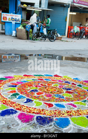 Rangoli designs in an Indian street , during the hindu festival of Sankranthi - Stock Photo