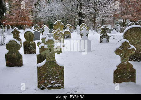 Churchyard with snow covered gravestones after snowfall. Dorset, UK December 2010 - Stock Photo