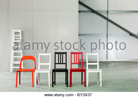 Five chairs in a row in a warehouse - Stock Photo