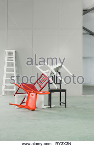 Five chairs piled on top of each other - Stock Photo