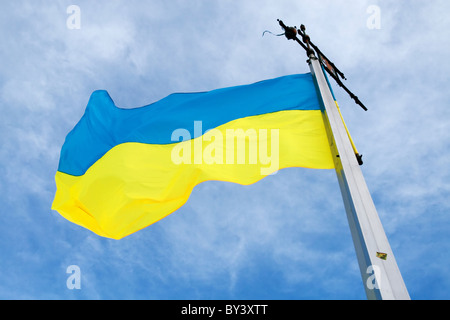 Ukrainian flag against blue sky - Stock Photo