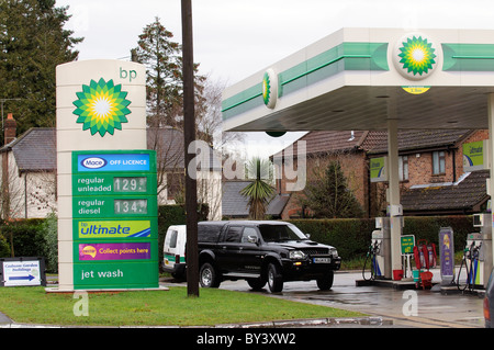 Road fuel prices on display at a BP filling station in Cadnam Hampshire southern England UK - Stock Photo
