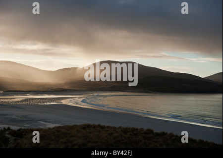 Rain falling over Isle of Harris, Viewed from Luskentyre Beach, Outer Hebrides, Scotland - Stock Photo
