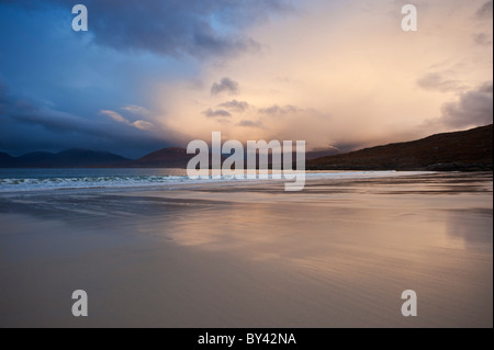 Rain clouds at sunset over Luskentyre beach, Isle of Harris, Outer Hebrides, Scotland - Stock Photo