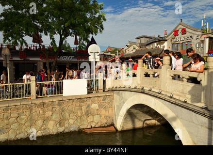 Jin Dynasty Yinding bridge near lake Qianhai and Lake Houhai in the Shichahai district of Beijing, China CN - Stock Photo