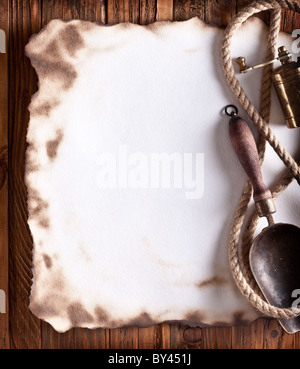 Image of old paper on a wooden board. - Stock Photo