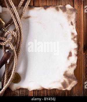 Image space of old paper on a wooden surface - Stock Photo