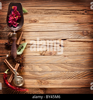 Image texture of old wooden boards with kitchen spices. - Stock Photo