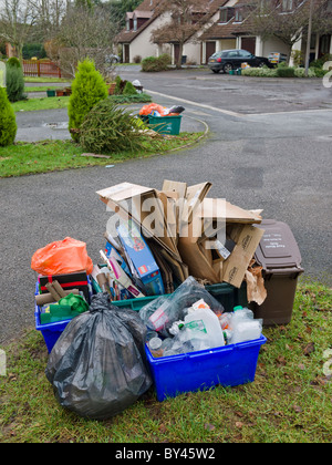 Overflowing kerbside recycling awaiting collection after delays due to poor weather. - Stock Photo