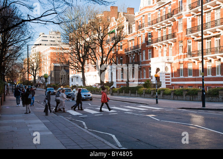 Zebra Crossing in Abbey Road made famous by the Beatles album cover for Abbey Road, London, Uk - Stock Photo