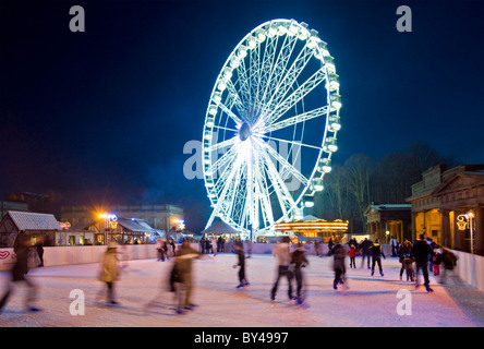 The Big Wheel & Ice Rink at Chester Victorian Christmas Market, Castle Grounds, Chester, Cheshire, England, UK - Stock Photo