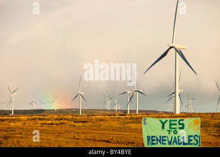 A rainbow over Whitlee wind farm on Eaglesham Moor just south of Glasgow in Scotland - Stock Photo
