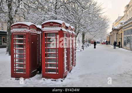 red telephone boxes in the promenade cheltenham UK - Stock Photo