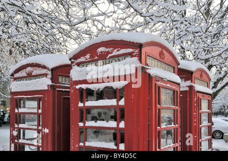 traditional telephone box in the UK - Stock Photo