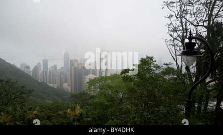 Disappearing buildings by fog and cloud, Hong Kong - Stock Photo