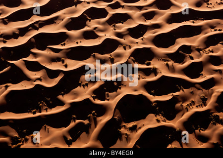 Aerial view over sand dunes, Namib Desert, Namibia - Stock Photo