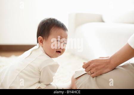 Baby Boy Crying Beside Mother - Stock Photo
