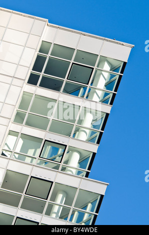 Windows of an empty penthouse suite in a tall office and apartment block - Stock Photo