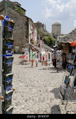 The strolling tourists in the famous Kujundziluk Bazaar area in the old town of Mostar on the east bank of the Neretva - Stock Photo