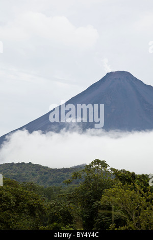 Cloud layer below Costa Rica's most active volcano The Arenal Volcano in Arenal National Park, Alajuela, Costa Rica. - Stock Photo