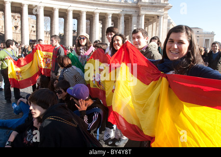 people crowd for 'Migrant day' migrant celebration in Vatican St Peter's square Spanish flag people community - Stock Photo