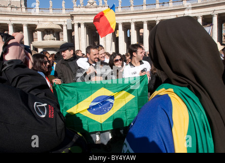 people crowd for 'Migrant day' migrant celebration in Vatican St Peter's square Brazil Brazilian flag people community - Stock Photo