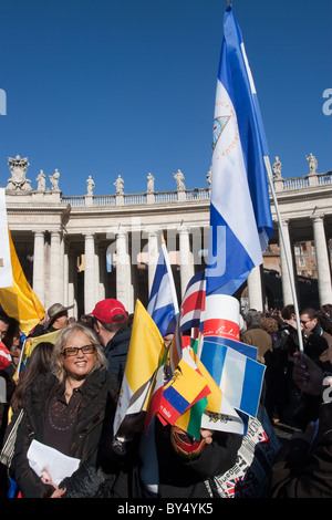people crowd for 'Migrant day' migrant celebration in Vatican St Peter's square flags people community - Stock Photo
