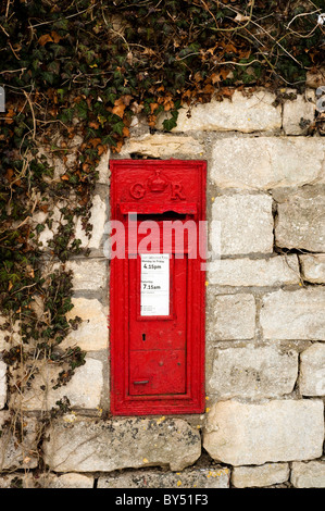Old red GR post box set into the wall at Ruscombe near Stroud, Gloucestershire, England, United Kingdom - Stock Photo