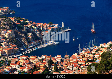 Greece, Symi island, Dodecanese. Panoramic view of Gyalos, capital and main port of the island. - Stock Photo