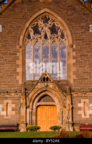 Reflections on the huge arched windows above the main entrance of the1870 Lochee Parish Church in Dundee,UK - Stock Photo